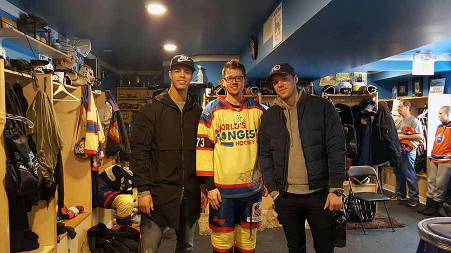 Adam Humeniuk with Edmonton Oilers Darnell Nurse and Connor McDavid at the World's Longest Hockey game at Saiker's Acres