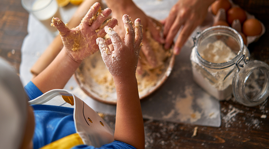 kids and parent with messy hands from baking