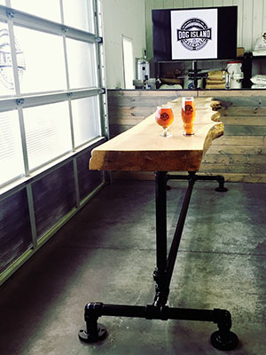 Ben Fiddler learned to weld to build this pipe and poplar table for Dog Island Brewing