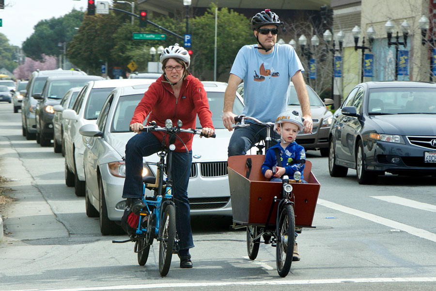 family cycling in a city
