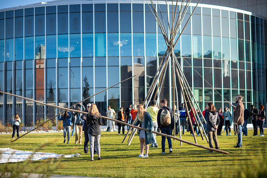 Setting up a tipi on main campus at NAIT