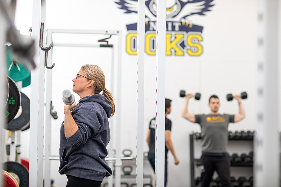 Woman trains in the NAIT fitness centre