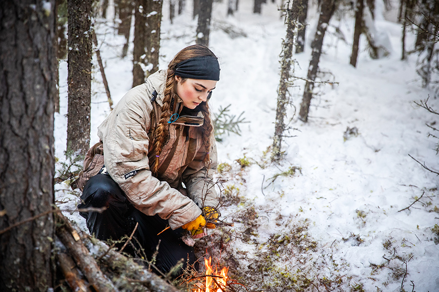 NAIT Conservation Biology student builds a fire in a survival situation