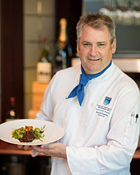 NAIT Culinary Arts instructor Norman Brownlee with a surprising and savoury chocolate and salmon dish.