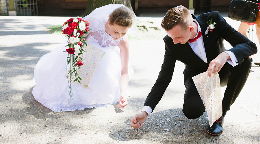 wedding budget, couple picks up coins