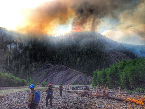peace river unit fighting a wildfire on the Alberta-B.C. border