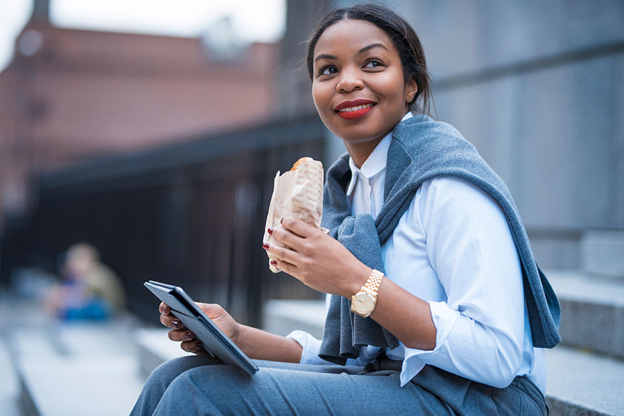woman eating lunch outdoors