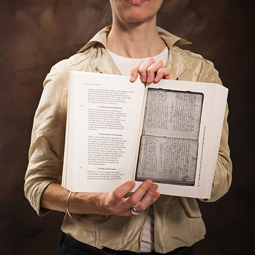 Kristine Kowalchuk holds the book Preserving on Paper